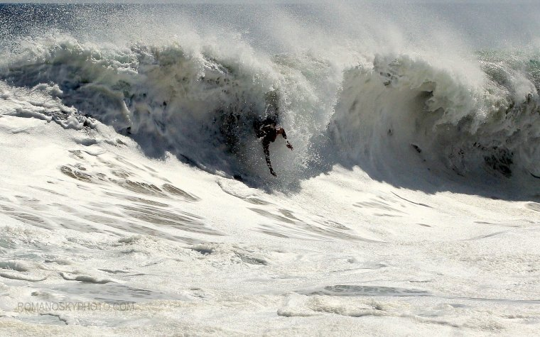 Not a big wave, but a rare right.  The lighting and white water dramatize the image some.  Rider ?