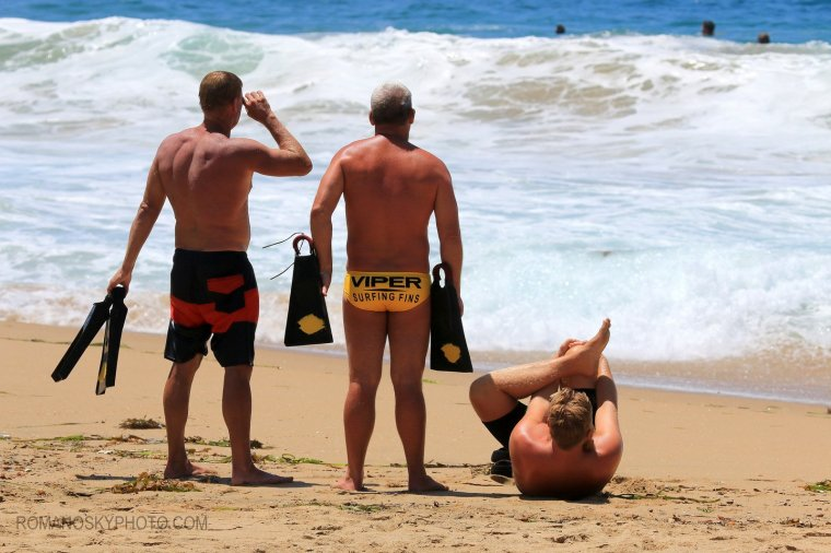 Long time bodysurfers Rick Piani and Craig Plitt standing next to a stretching Sean Starky.   These three represent 60 or more years of Wedge experience.