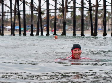 Eventual age group champion Chris Lafferty takes a breath while the rest of his semi-final heat tries to catch up.