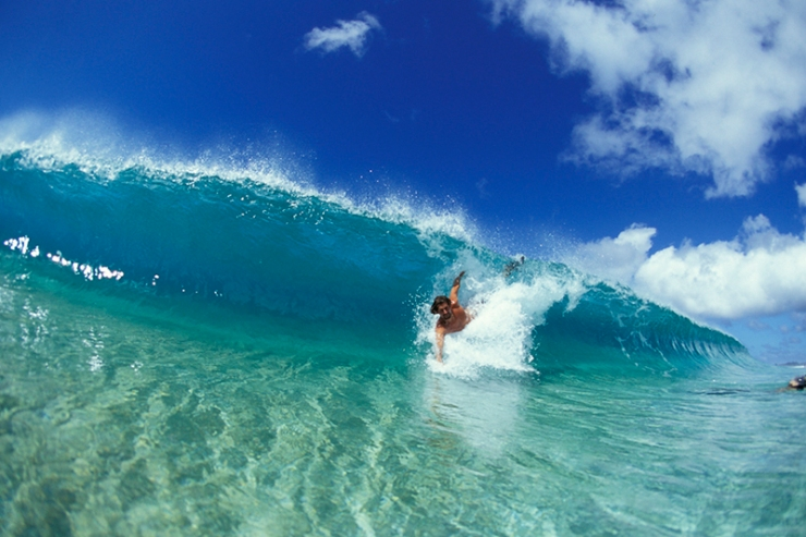 Daren Crawford bodysurfing at Pupukea.
