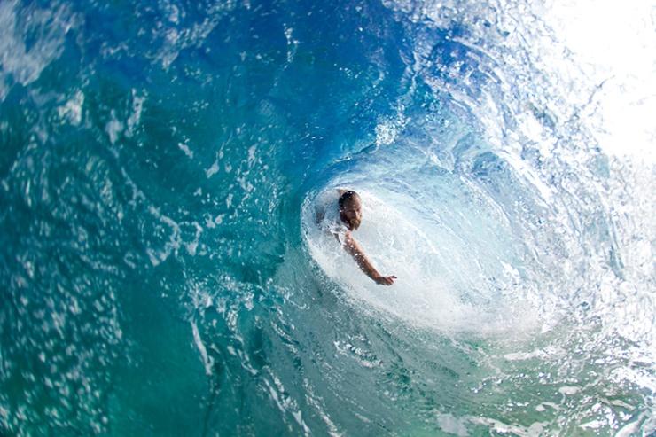 Keith Malloy bodysurfing at Pupukea.